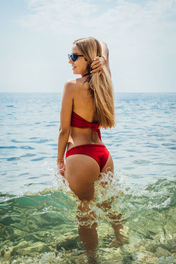 Water Sea Young Adult Swimwear Bikini Clothing Young Women Hair One Person Leisure Activity Blond Hair Real People Lifestyles Horizon Horizon Over Water Hairstyle Fashion Adult Beautiful Woman Outdoors