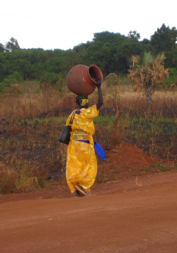 Africa African Carrying Clay Pot Colorful Gulu Heavy Travel Travel Photography Uganda  Woman Yellow Colour Of Life
