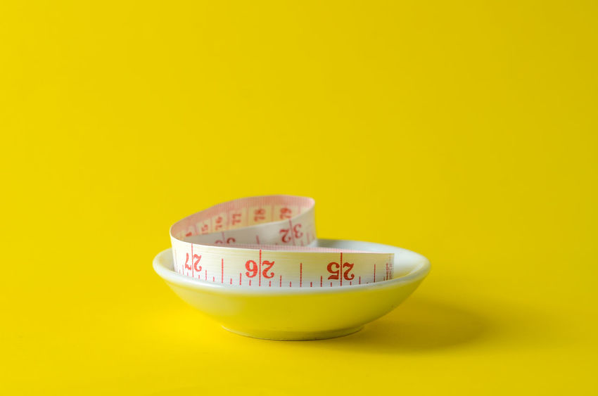 Bowl Close-up Colored Background Copy Space Cut Out Focus On Foreground Food Food And Drink Freshness Healthy Eating Indoors  No People Single Object Still Life Studio Shot Text Two Objects Wellbeing Yellow Yellow Background