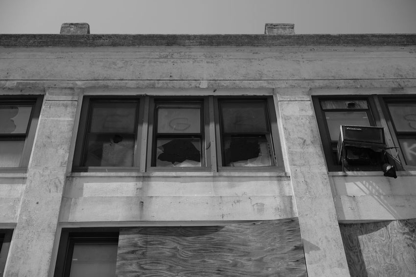 Riis Beach Abandoned Buildings Architectural Column Architecture Blackandwhite Photography Broken Windows Building Exterior Built Structure Day Fujifilm_xseries FujifilmX_US Lookingup Low Angle View No People Outdoors Photographyisthemuse Window