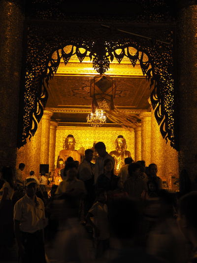 Inside of a temple during the full moon festival Full Moon Festival Illuminated Lifestyles Night Place Of Worship Shrine Temple Temple - Building Tourism Yangoon Myanmar