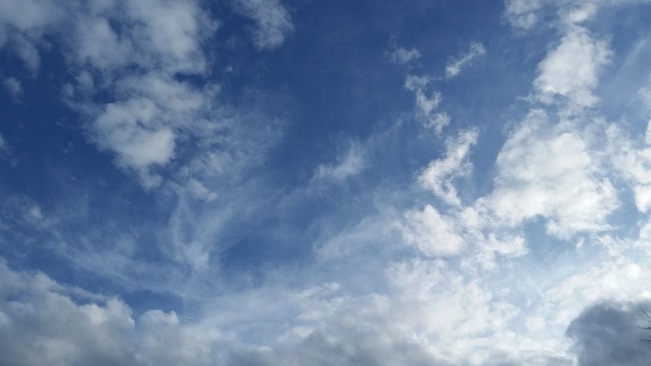 sky, cloud - sky, beauty in nature, nature, low angle view, blue, backgrounds, scenics, day, tranquility, no people, sky only, outdoors, full frame, tranquil scene