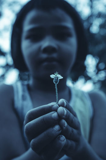 darkness and light,portrait One Person Real People Leisure Activity Front View Lifestyles EyeEmNewHere EyeEm Best Shots Enjoying Life EyeEm Nature Lover EyeEm Selects Kid Girl Human Hand Human Face Day Dark darkness and light Portrait People Petal Tone Childhood Child Kids Green Color
