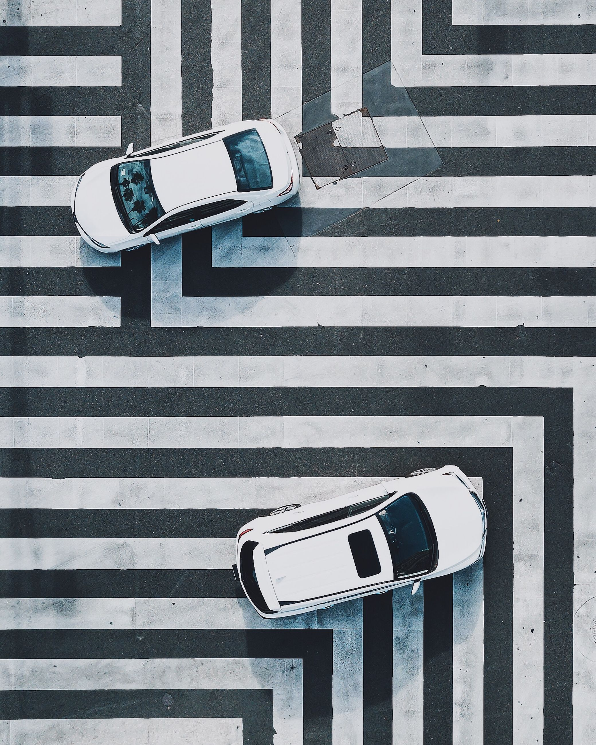 high angle view, sign, symbol, crosswalk, transportation, zebra crossing, crossing, road marking, communication, marking, technology, street, city, road, day, mode of transportation, land vehicle, striped, motor vehicle, car, no people, outdoors