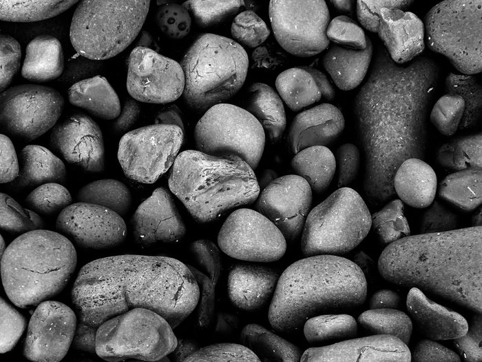 Stones Simple Moment Backgrounds Black Stone Stone - Object Pebble Beach Full Frame Shore Nature Pebble Beach Large Group Of Objects Sand No People Water Outdoors Beauty In Nature Day Close-up
