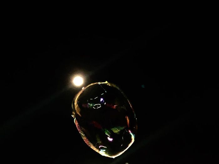 Close-up of bubbles against black background