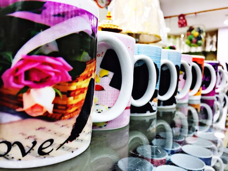 Cups Text Western Script Communication Close-up Selective Focus Multi Colored Large Group Of Objects No People Freshness