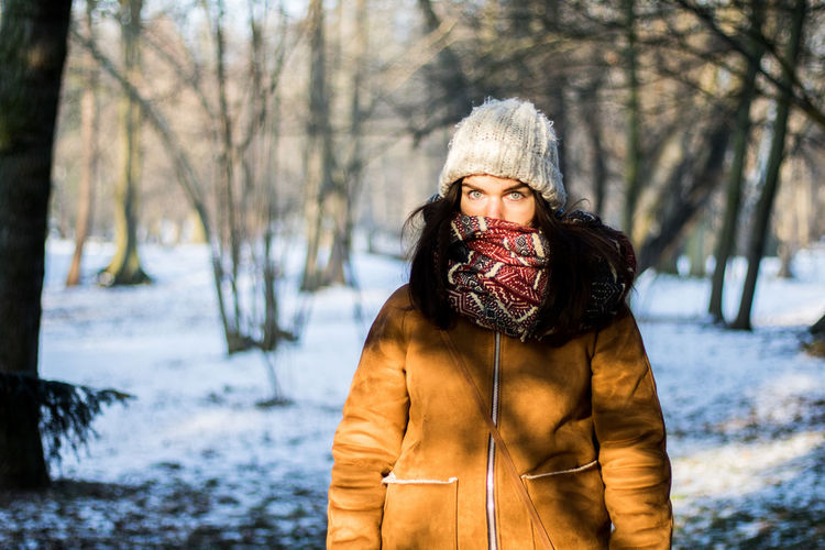 Winter Warm Clothing Cold Temperature Snow Tree One Person Mature Adult Winter Coat Adults Only Outdoors People Adult Bare Tree Snowflake Forest One Woman Only Only Women Nature Blue Eyes Looking At Camera Young Adult Adults Only Woman Portrait Portrait Uniqueness
