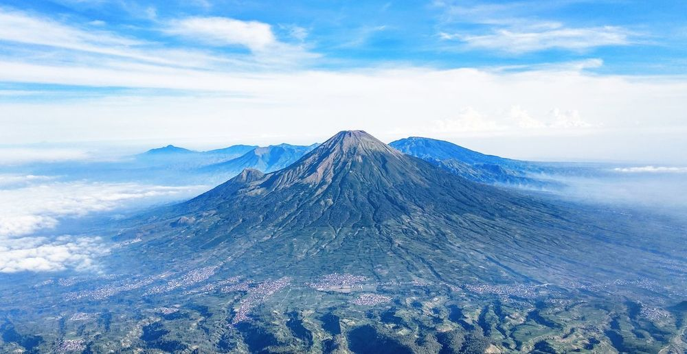 views of Sindoro Mountain from Sumbing Mountain Sindoro Sumbing Mountain View Pesonaindonesia Wonosobo Indonesia Photography  INDONESIA Landscape Landscape_photography Snow Sky Mountain Peak EyeEmNewHere