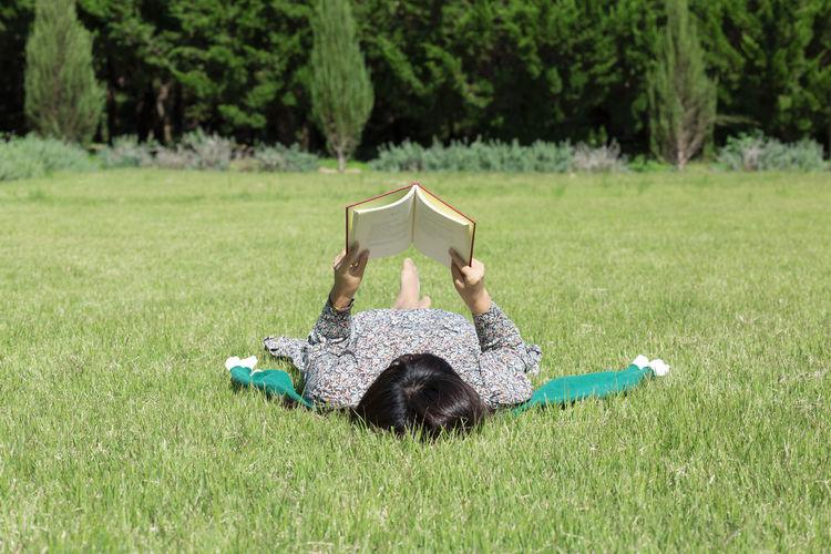 Man lying down on grassy field