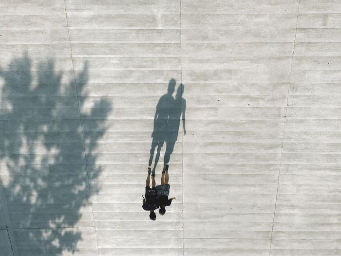 High angle view of couple walking outdoors