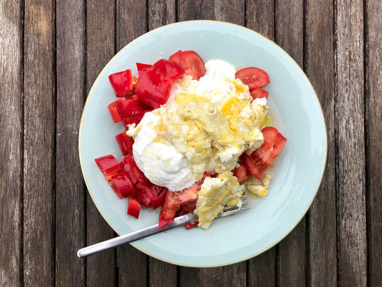 Scrambled eggs with yoghurt and tomato Healthy breakfast Breakfast Dairy Product Directly Above Egg Food Food And Drink Freshness Healthy Eating High Angle View No People Plate Ready-to-eat Serving Size Table Tomato Vegetable Wellbeing Wood - Material