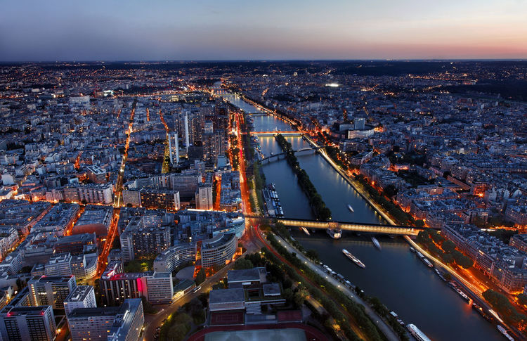 Aerial night view of Paris with River Seine City Cityscape France Paris Travel Aerial View Background Illumination Night River Seine Travel Destinations Mobility In Mega Cities