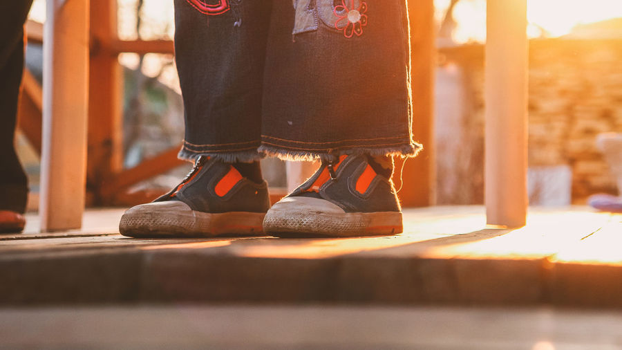 Children's feet in shoes, sunset Cildren Close-up Girl Human Body Part Human Leg Human Limb Lifestyles Low Section People Real People Shoe Standing Sunset Togetherness Traditional Clothing
