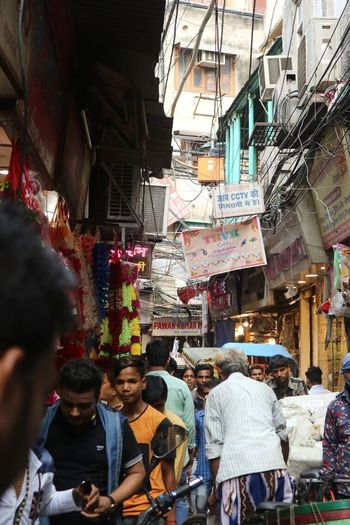 Delhi street scene Real People Large Group Of People Market Women City Life Built Structure Architecture Building Exterior Lifestyles City Outdoors Day Crowd Group Of People Adult People Adults Only