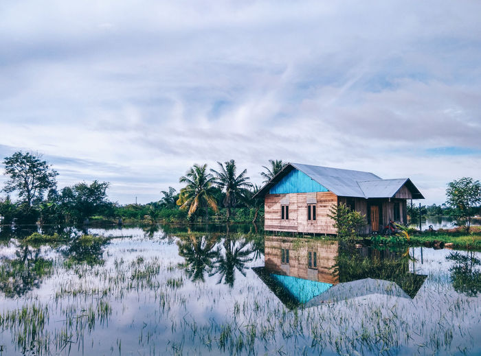 flooded Architecture Beauty In Nature Building Exterior Built Structure Cloud - Sky Day EyeEmNewHere Grass House Lake Lakeside Miles Away Nature No People Outdoors Reflection Sky Tranquil Scene Tranquility Tree Water The Secret Spaces The Great Outdoors - 2017 EyeEm Awards The Photojournalist - 2017 EyeEm Awards