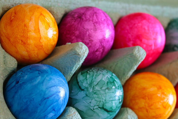 Close-up of multi colored eggs