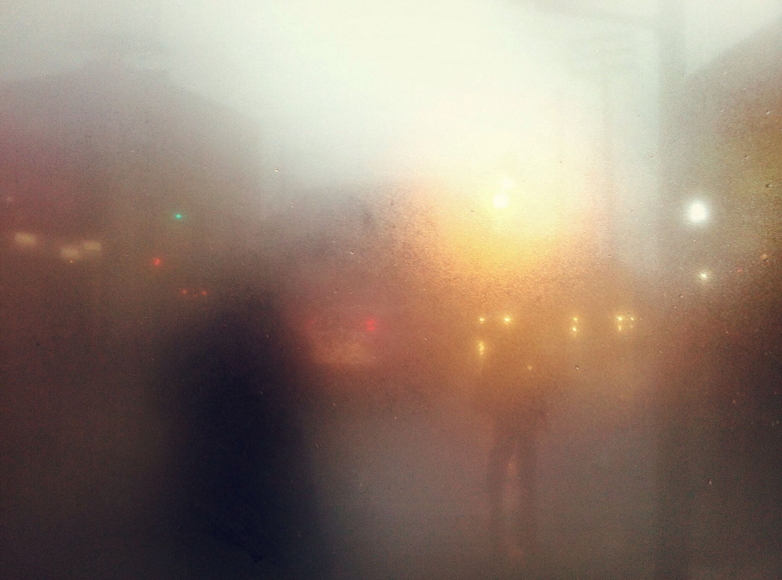illuminated, rain, wet, weather, transparent, defocused, glass - material, window, night, drop, indoors, fog, sky, lighting equipment, no people, water, backgrounds, street light, season, dusk
