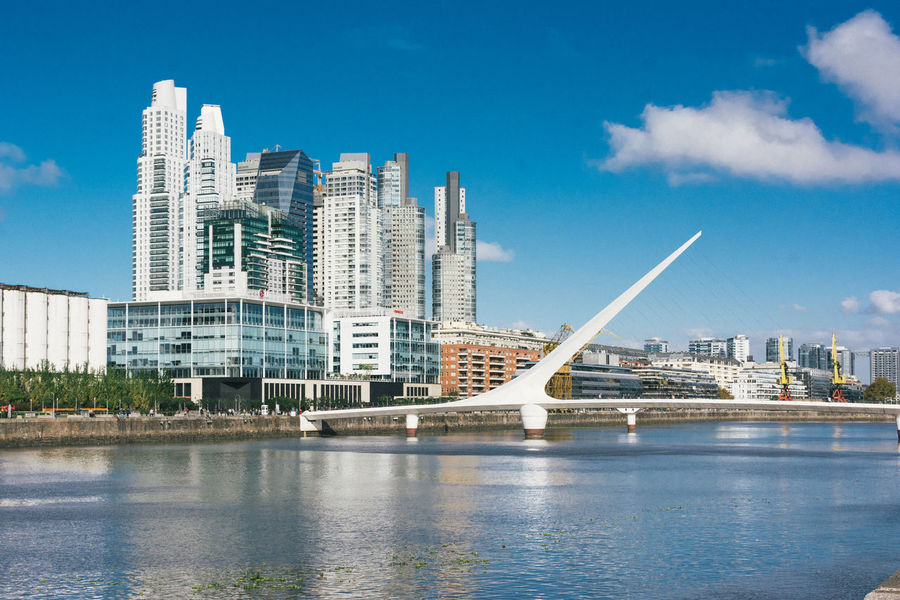 Architecture Blue Bridge Building Building Exterior Built Structure Cityscape Day Financial District  Lifestyles Office Building Outdoors Puente De La Mujer Puerto Madero Residential District Sky Skyline Skyscraper Travel Travel Destinations Traveling Urban Skyline Water