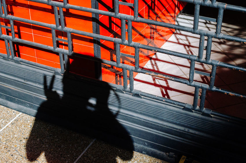 Saying Hi! Shadow Industry Occupation Transportation Sunlight Motion Orange Color Blurred Motion Outdoors Architecture Day on the move Metal Construction Site Working Construction Industry One Person Business Mode Of Transportation Focus On Shadow EyeEm Best Shots EyeEm Selects