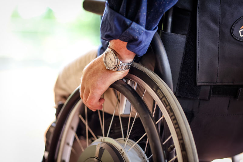 Wheels Wheelchair Disability  Ability Quadriplegic Spinal Injury Wheelchair Access Wheelchair Photography Wheelchairs Assistive Device Wheels One Person Medical Equipment Hand Differing Abilities Human Body Part Physical Impairment Human Hand Sitting Real People Wheel Men Healthcare And Medicine Day