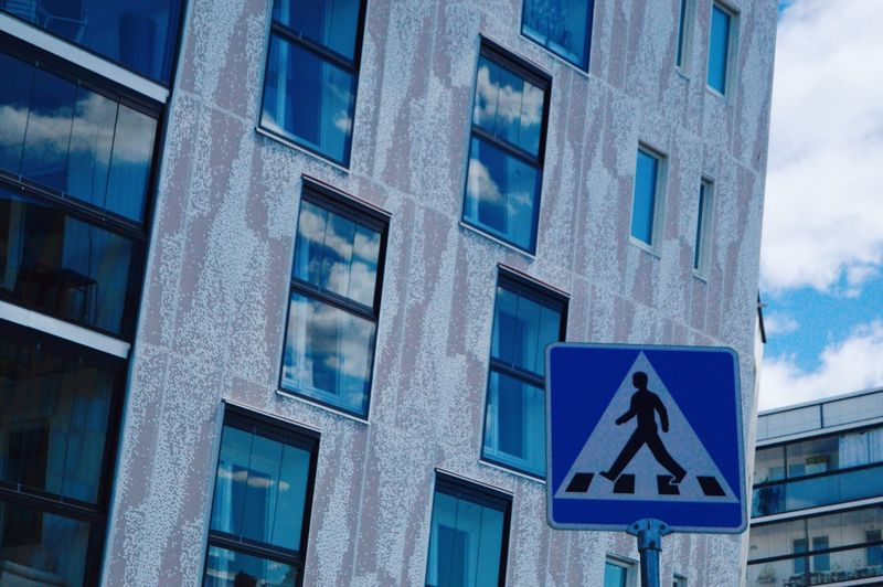 Residential Neighborhood Travel Destinations Sign Built Structure Communication Architecture Building Exterior Low Angle View Road Sign No People Building Window Day Guidance City Cloud - Sky Outdoors Symbol Representation Blue My Best Photo The Architect - 2019 EyeEm Awards