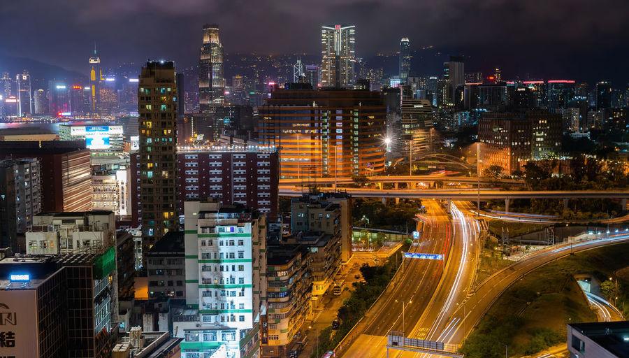 High angle top view of illuminated city buildings at night,hong kong