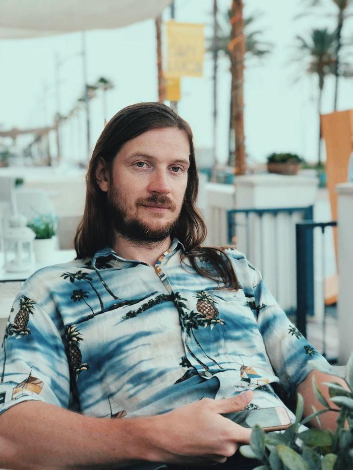 Portrait of man sitting outdoors
