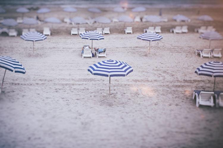 Beach Beachview Bleu And White Leisure Activity Lifestyles Sand Selective Focus Stripes Everywhere Summer Sunbeds And Umbrella Umbrela Umbrella View Wet