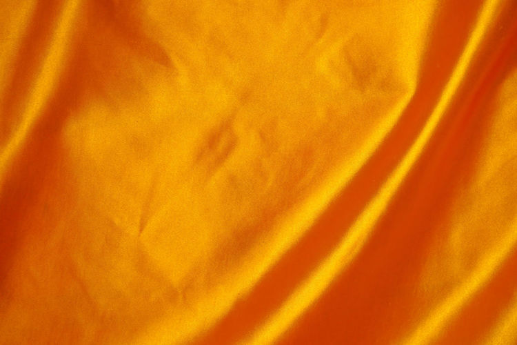 Backgrounds Full Frame Abstract Textile No People Pattern Textured  Orange Color Yellow Rippled Vibrant Color Abstract Backgrounds Folded Crumpled Indoors  Close-up Softness Linen Material Wrinkled Luxury