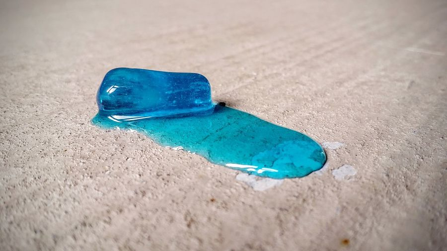 Blue Color Hard Candy  Melting Blue Candy Cement Close-up Day Jolly Rancher Melted No People Outdoors Shadow Single Object