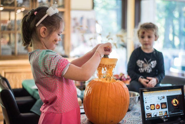 Cute boy holding pumpkin at home
