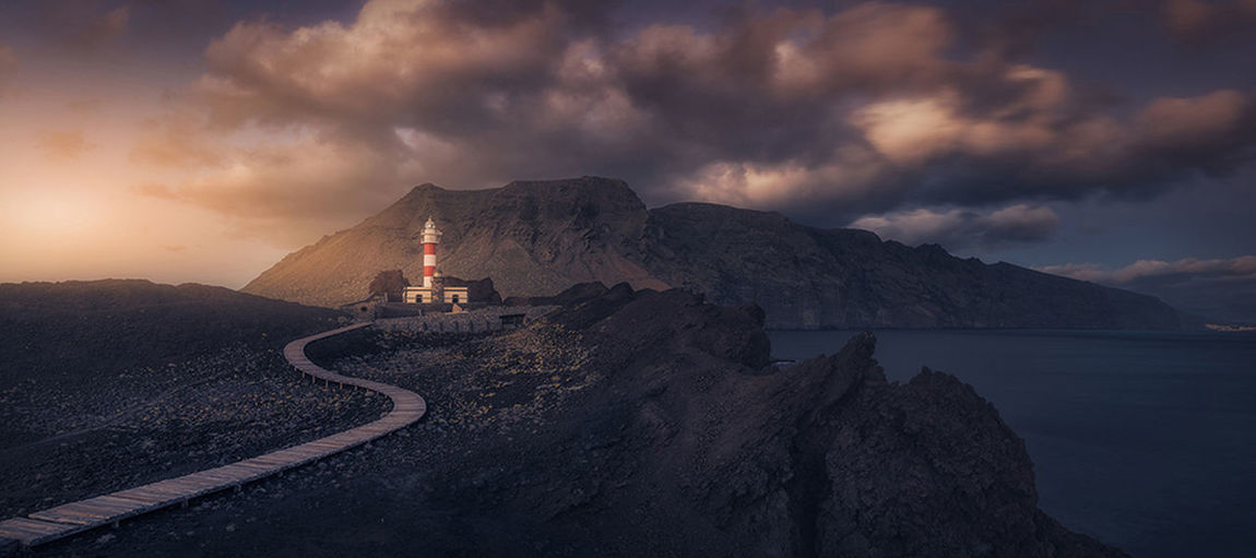 The lighthouse in Teno, Tenerife, Spain Cloud - Sky Composition Dramatic Sky Lighthouse Mountain No People Outdoors Panorama Scenics Sea Sunset Tenerife Island The Great Outdoors - 2017 EyeEm Awards