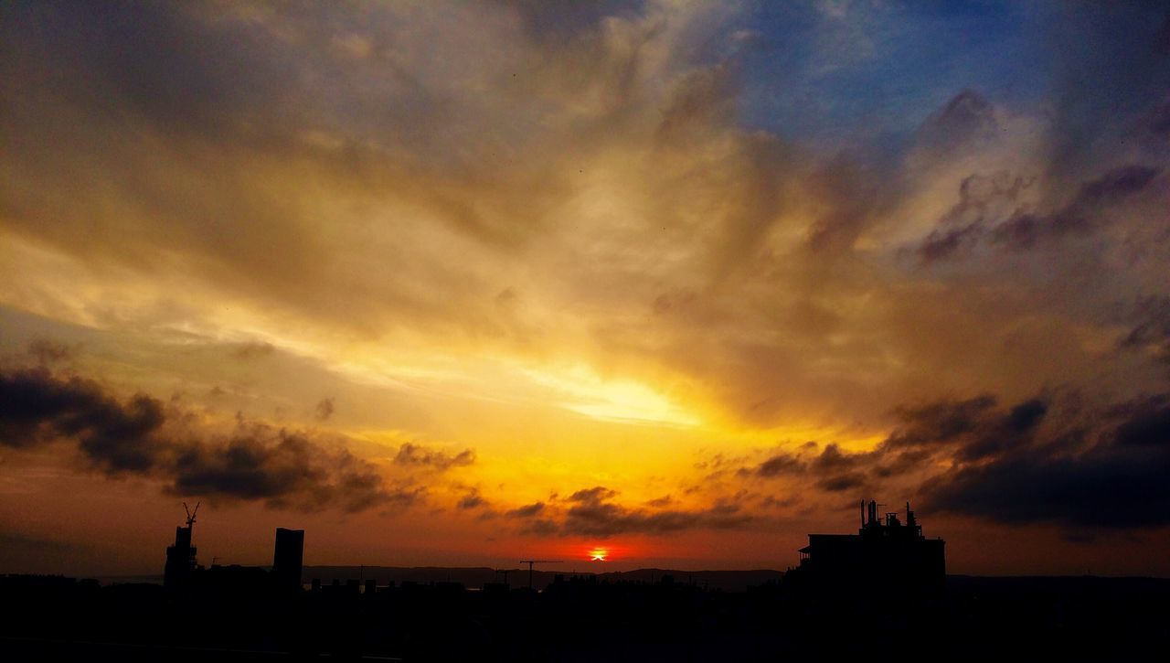 sky, cloud - sky, sunset, architecture, built structure, building exterior, silhouette, building, orange color, nature, no people, beauty in nature, outdoors, tower, scenics - nature, city, dramatic sky, religion, place of worship