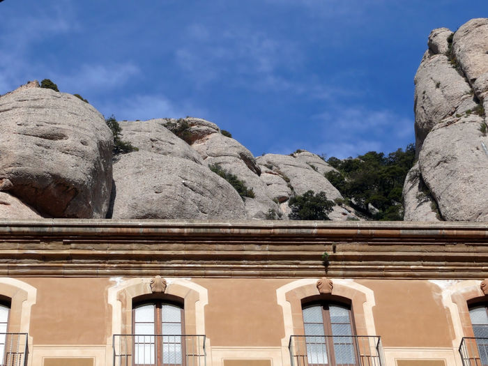 Low angle view of building against sky in santa maria de montserrat abbey