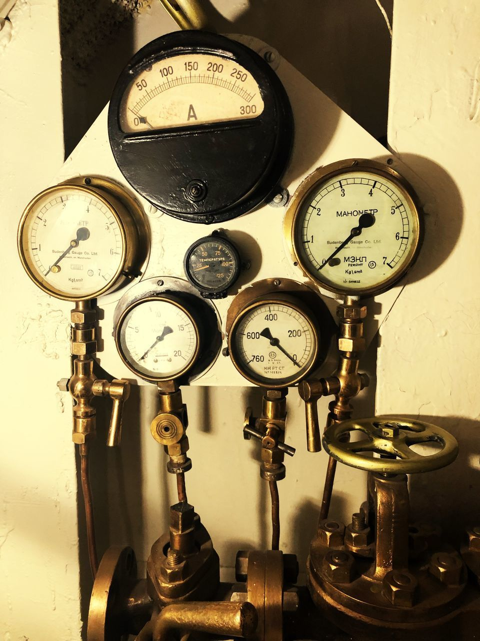machinery, gauge, instrument of measurement, equipment, indoors, number, machine part, pressure gauge, accuracy, no people, technology, physical pressure, industry, measuring, manufacturing equipment, meter - instrument of measurement, wall - building feature, close-up, factory, dial, clock, industrial equipment