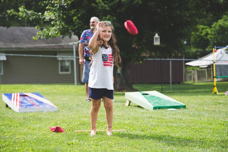 Full length of girl standing on field