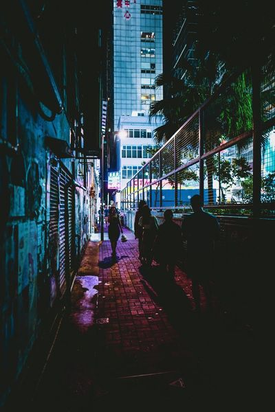 Discoverhongkong Street Photography Nightshooters Nightscapes Reframinghk cityscapes Architecture Built Structure Building Exterior Real People Illuminated City Night Group Of People Walking Building Direction City Life The Way Forward Transportation People Outdoors Leisure Activity Men Lifestyles Street