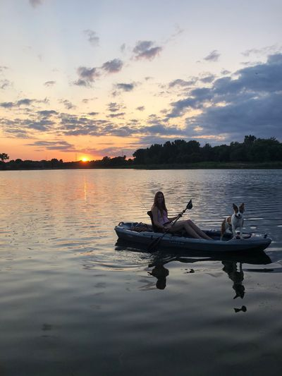 Girl and a dog in a kayak at sunset Dogs Of EyeEm Girl Water Sky Sunset Reflection Transportation Cloud - Sky Tranquility Beauty In Nature Nautical Vessel Mode Of Transportation Nature Tranquil Scene Scenics - Nature Lake Tree Non-urban Scene Outdoors Beach