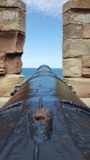 Canon In Fort By Sea Against Sky