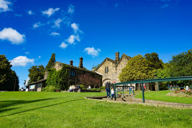 Leeds, England, United Kingdom - September 25, 2016: Abbey House Museum in Kirkstall, Leeds, West Yorkshire, England Grass Plant Architecture Sky Built Structure Building Exterior Tree Cloud - Sky Building Nature Blue Day Lawn Green Color Travel Destinations Landscape Incidental People Land Field Environment Outdoors Travel Destination Tourism Tourist Atrraction House Landmark Blue Sky Attraction Tree Plant Garden