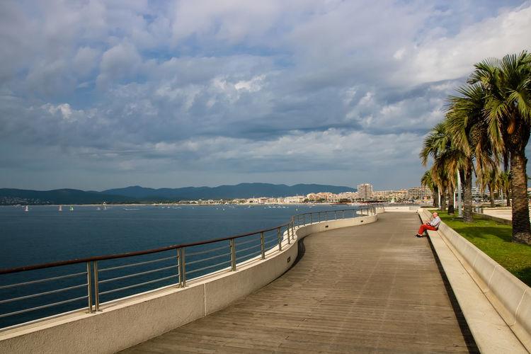 Promenade against cloudy sky