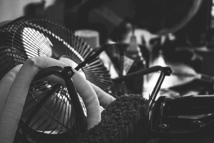 Close-up of brush by electric fan