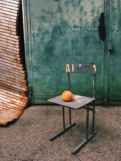 View of orange fruits on chair