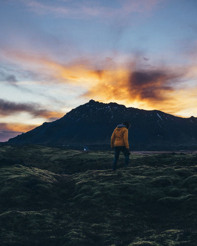 Iceland Snaefellsnes Peninsula Cloud - Sky Sky Mountain Beauty In Nature Sunset One Person Nature Scenics - Nature Real People Rear View Standing Leisure Activity Tranquility Tranquil Scene Lifestyles Non-urban Scene Full Length Orange Color Outdoors