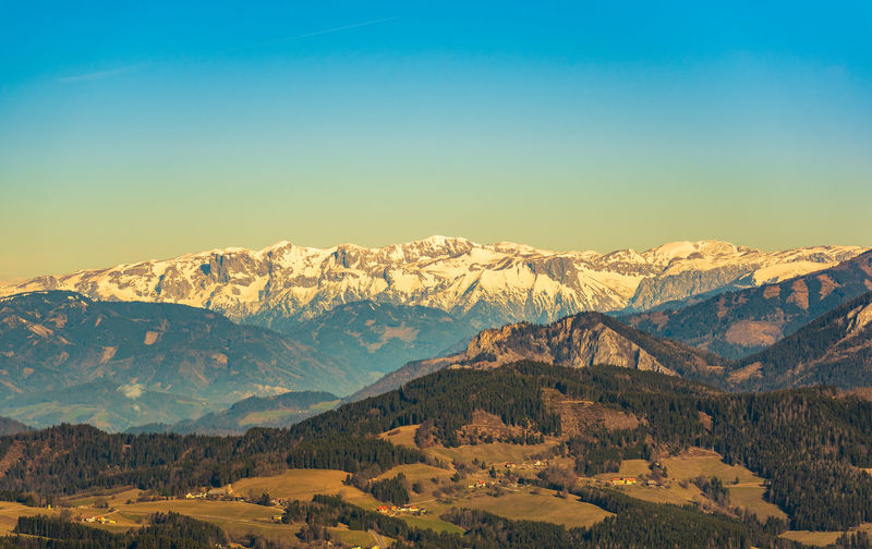 Scenic view of snowcapped mountains against clear sky