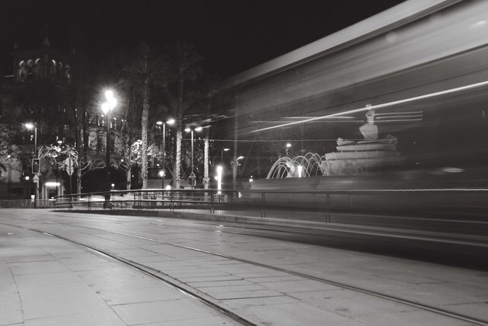 Night scene in Seville SPAIN City Sevilla Photoproject EyeEmNewHere EyeEm Best Shots - Black + White Citybynight Blackandwhite Photography Cityscape Nightphotography Illuminated Transportation Night Speed Long Exposure Motion Mode Of Transport Public Transportation Rail Transportation Light Trail Street Light No People Architecture Blurred Motion Outdoors High Street Built Structure The Street Photographer - 2018 EyeEm Awards