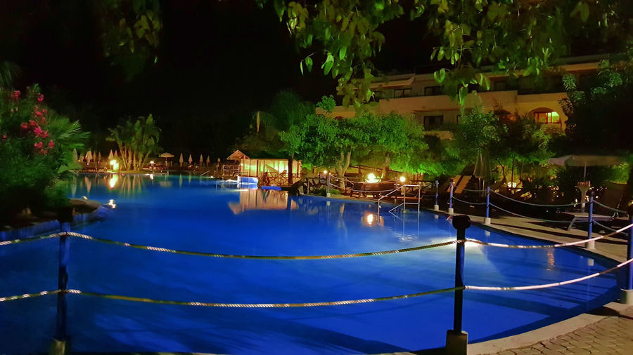 Scenic view of swimming pool at night