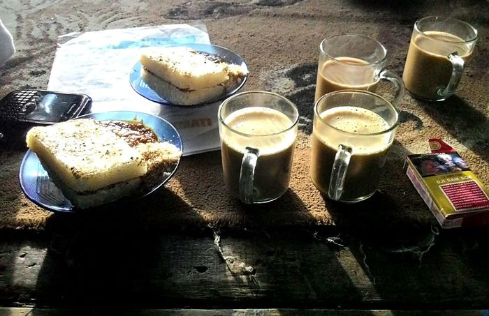 Coffee, cigarettes, and ketan bakar is a morning dish that is served by local residents in tangkuban parahu mount area, taken with Asuszenfone5