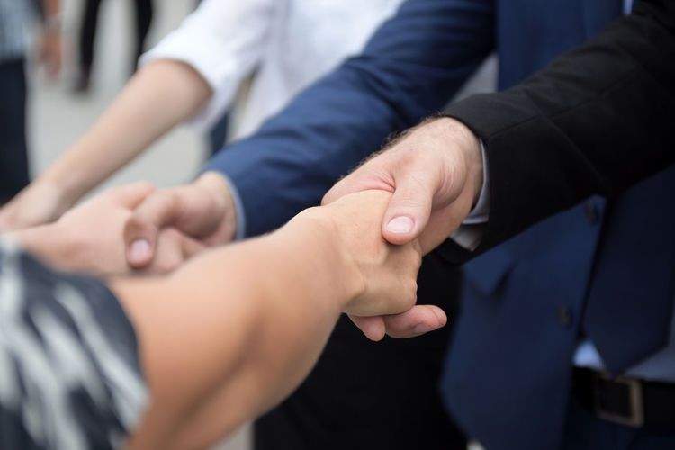 Business coworkers shaking hands in office